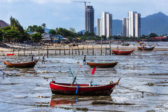 Fishing boats on the beach mud Royalty Free Stock Photos