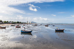 Fishing boats on the beach mud Stock Photos
