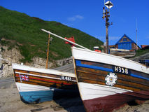 Fishing Boats on the Beach. Old fishing boats moored on the beach and slipway at North Landing, Flamborough, United Kingdom Royalty Free Stock Photography