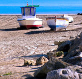 Fishing boats on the beach Stock Images