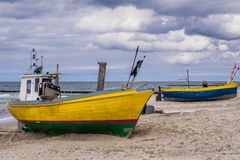 Fishing boats in Poland. Fishing boats on a beach in Rewal, Poland Royalty Free Stock Photos