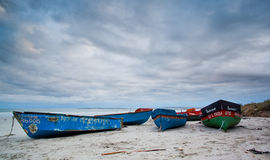 Fishing boats on a beach Stock Photography