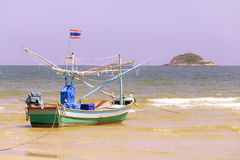 Fishing boats on the beach. - (Shallow of focus) stock photo