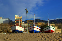 Fishing boats on the beach Stock Photos