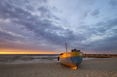 Fishing boats on the beach during a storm Royalty Free Stock Photography