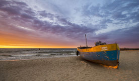 Fishing boats on the beach during a storm. Baltic sea coast, Poland royalty free stock image