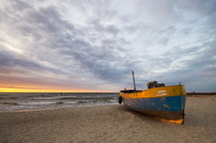 Fishing boats on the beach during a storm. Baltic sea coast, Poland stock photography