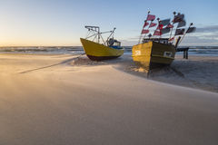 Fishing boats on the beach during a storm Royalty Free Stock Images