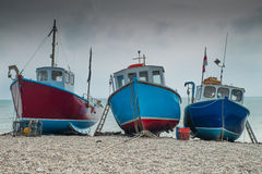Fishing boats on Beer beach, Dorset, England Royalty Free Stock Images