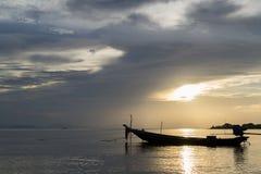 Fishing boats beneath sunset. Alone fishing boats beneath sunset Stock Photo