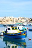 Fishing boats in Birzebugga habour, Malt. Traditional Maltese fishing boats in the harbour, Birzebbuga, Malta, Europe Royalty Free Stock Photography