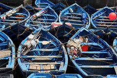 Fishing Boats. Blue fishing boats moored in the harbor of the sea side village of Essaouira, Morocco Stock Image