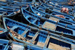 Fishing Boats. Blue fishing boats moored in the harbor of the seaside village of Essaouira, Morocco Royalty Free Stock Image