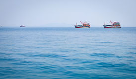 Fishing boats on the blue sea in Koh Chang, Thailand Stock Photo