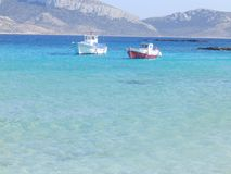 Fishing boats in the blue sea stock photos