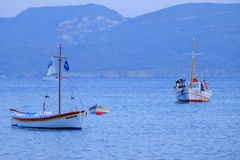 Fishing boats on blue sea Stock Image
