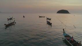 Fishing boats in the bay, schooner, sea, thai, thailand, yacht, sunset, beach, ship, drone flight 4k. Fishing boats in the blue water bay, schooner, sea, thai stock footage