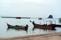 Fishing Boats at Black Sand Beach Langkawi Malaysia. Fishing boat with no people Royalty Free Stock Photos