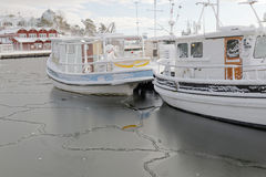 Fishing boats boat in the small harbor during winter time Royalty Free Stock Photos