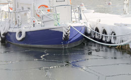 Fishing boats boat in the small harbor during winter time Royalty Free Stock Photo