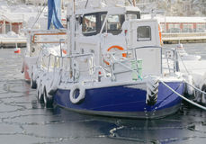 Fishing boats boat in the small harbor during winter time Stock Image