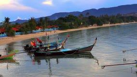 Fishing boats bobbing in the sea at sunset,. Fishermen preparing to sail. Video 1920*1080 stock video