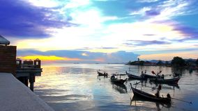 Fishing boats bobbing in the sea at sunset. Fishermen preparing to sail. Video stock video footage