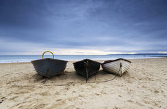 Fishing Boats on Bournemouth Beach. Fishing boats under a brooding sky at Durley Chine on Bournemouth beach Royalty Free Stock Photography