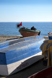 Fishing boats on the Burriana Beach at the Spanish resort of Nerja on the Costa del Sol Royalty Free Stock Images