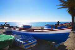 Fishing boats on the Burriana Beach at the Spanish resort of Nerja on the Costa del Sol Stock Images