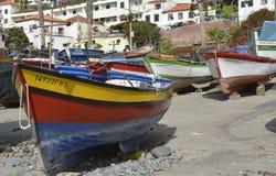 Fishing boats at Camara de Lobos, Madeira, Portugal. Fishing boats drawn up on beach and slipway at Camara de Lobos in Madeira, Portugal Stock Images