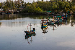 Fishing boats in canal near the sea Royalty Free Stock Photography