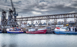 Fishing boats at Cape Town dock on a cloudy day Royalty Free Stock Photography