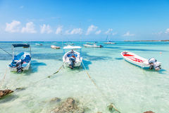 Fishing boats on a Caribbean beach Royalty Free Stock Image