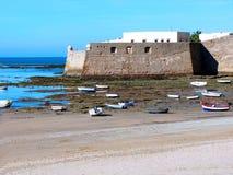 Fishing boats and castle of Santa Catalina in Cadiz Royalty Free Stock Image
