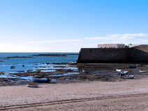 Fishing boats and castle of Santa Catalina in Cadiz Royalty Free Stock Photos