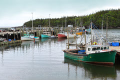 Fishing Boats in Chance Harbor, New Brunswick. Colorful fishing boats docked in Chance Harbor, New Brunswick, Canada stock images