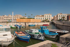 Fishing boats in the city of Syracuse, Sicily Stock Photos