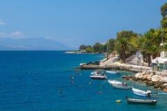 Fishing boats at the coast of Greece in Loutraki Stock Photos