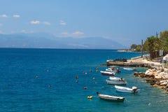 Fishing boats at the coast of Greece in Loutraki Royalty Free Stock Photos