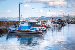 Fishing boats on the coastline of Crete royalty free stock image