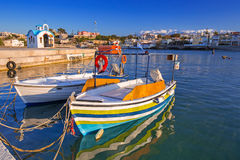 Fishing boats on the coastline of Crete. Fishing boats on the coastline of Kato Galatas town on Crete, Greece Royalty Free Stock Images