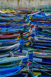 Fishing boats. Colorful Portuguese fishing boats ligned up on a sunny day. Vertical picture Royalty Free Stock Image