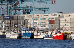 Fishing boats at container terminal Stock Photos