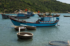 Fishing boats and coracles in the bay Stock Photo