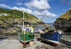 Fishing Boats in Cornwall. Colourful fishing boats on the beach at Portlooe a small fishing village on the south coast of Cornwall Royalty Free Stock Photos