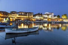 Fishing boats in costal city at night Stock Photo