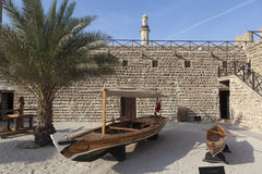 Fishing boats in the courtyard of Al Fahidi Fort. Dubai, United Arab Emirates. Royalty Free Stock Images