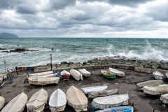 Fishing boats covered for sea in tempest in Genoa, Italy Royalty Free Stock Image