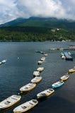 Fishing boats and cruise ship on lake Hakone Stock Images
